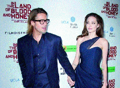 Brad Pitt and Angelina Jolie (left), who has written and directed In the Land of Blood and Honey, at the film's premiere