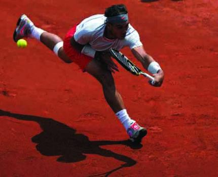 Spain's Rafael Nadal returns to Daniel Brands of Germany during their French Open first round match at Roland Garros in Paris on