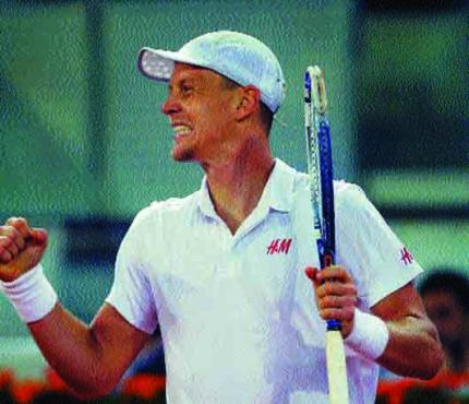 Tomas Berdych from the Czech Republic celebrates his 7-6, 6-4 win over Scotland's Andy Murray in the Madrid Open quarter-finals—