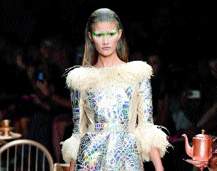 A model displays a creation by Manish Arora in Paris on Thursday. — AP